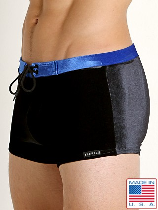 Model in black/royal Sauvage Velvet Riviera Swim Trunk