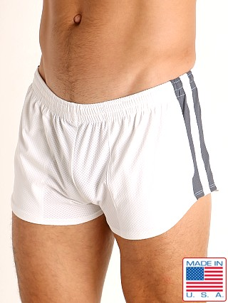 Model in white/grey LASC Performance Mesh Running Shorts