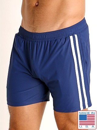 Model in navy/white LASC Performance Mesh Active Shorts