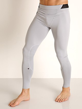 Model in mod gray Under Armour Rush HG Leggings