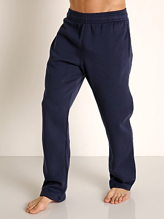 Model in midnight navy Under Armour Hustle Fleece Pant