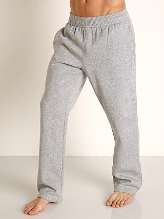 Model in true gray heather Under Armour Hustle Fleece Pant