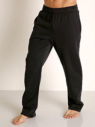 Model in black Under Armour Hustle Fleece Pant