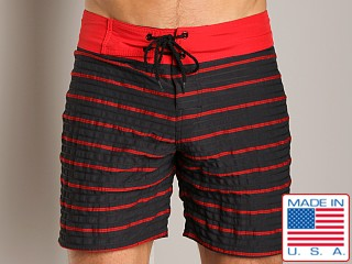 Model in red Sauvage Hunter Banded Surfshort