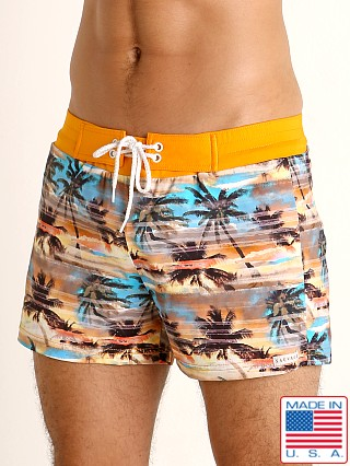 Model in print Sauvage Sunset Palms Swim Shorts