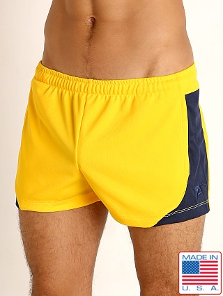 Model in gold/navy LASC Pique Mesh Lined Running Shorts