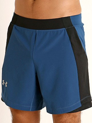 Model in petrol blue/reflective Under Armour Qualifier Speedpocket 7'' Short Petrol Blue/Reflect