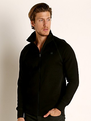 Model in dark black G-Star Jirgi Zip Top