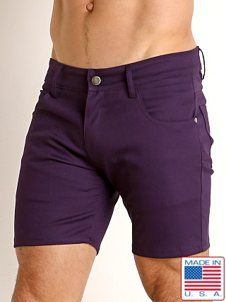 Model in eggplant LASC Cotton Twill 5-Pocket Shorts