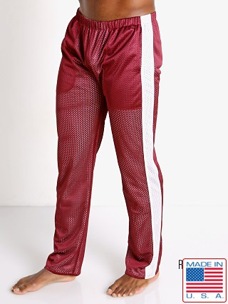 Model in burgundy/white LASC Reversible Athletic Mesh Pants