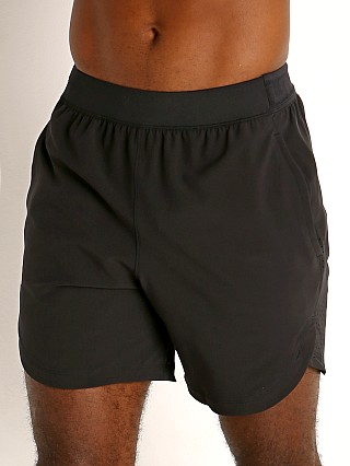 Model in black/metallic solder Under Armour Stretch Woven Shorts