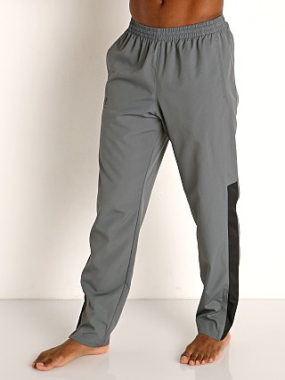 Model in pitch gray/black Under Armour Vital Woven Pants