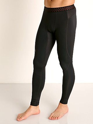 Model in black Under Armour Rush Heat Gear Leggings