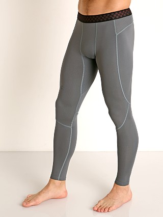 Model in pitch gray/black Under Armour Rush Heat Gear Leggings