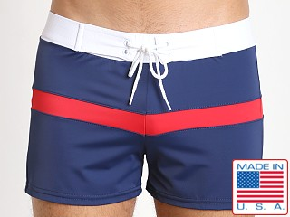Model in navy red white Sauvage Patriot Spliced Sport Swim Trunk