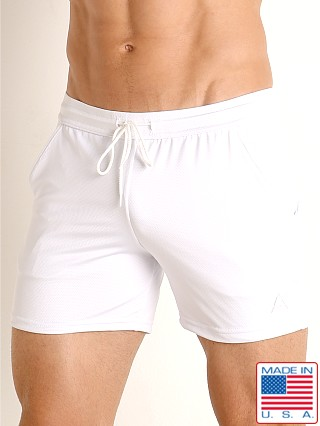 Model in white LASC Pique Mesh Performance Workout Short