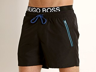 Model in black Hugo Boss Thornfish Swim Shorts
