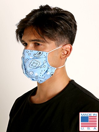 Model in sky blue LASC Fashion Face Mask Bandana Print