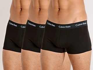 Model in black Calvin Klein Cotton Stretch Wicking Low Rise Trunk 3-Pack
