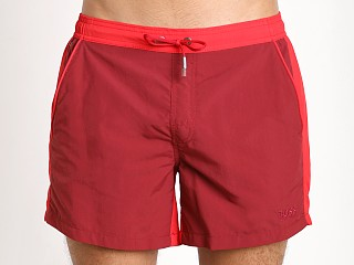 Model in burgundy/red Hugo Boss Snapper Swim Shorts