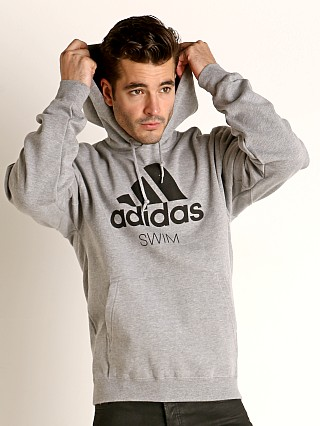 Model in grey Adidas Swim 10 Oz Fleece Hoodie