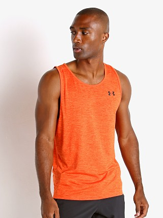 Model in rogue orange Under Armour Tech 2.0 Tank Top