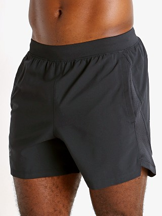 "Model in black Under Armour Launch 5"" Running Short"