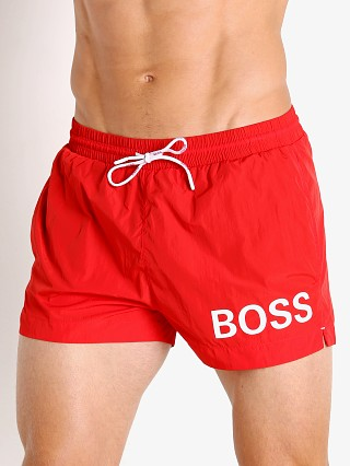 Model in red Hugo Boss Mooneye Swim Shorts