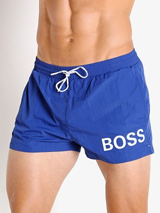 Model in blue Hugo Boss Mooneye Swim Shorts