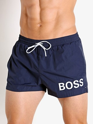 Model in navy Hugo Boss Mooneye Swim Shorts