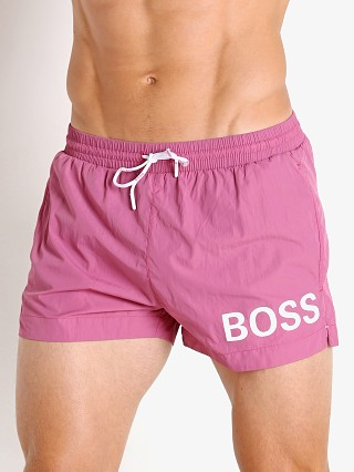 Model in mauve Hugo Boss Mooneye Swim Shorts
