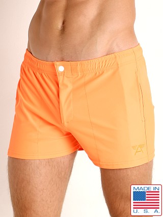 Model in neon orange LASC Malibu Swim Shorts