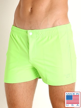 Model in neon lime LASC Malibu Swim Shorts