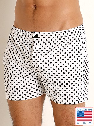 Model in white/black polka dots LASC Malibu Swim Shorts