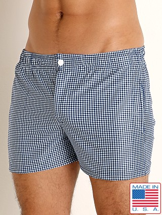 Model in navy gingham checks LASC Malibu Swim Shorts