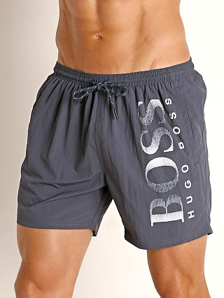 Model in charcoal Hugo Boss Octopus Swim Shorts