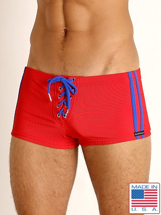 Model in red/cobalt Sauvage Football Lace-up Swim Trunk