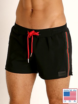 Model in black/red Sauvage Malibu Retro Lycra Swim Short