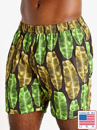 "Model in banana leaf print Sauvage 17"" Pull-On Surf Trunk"