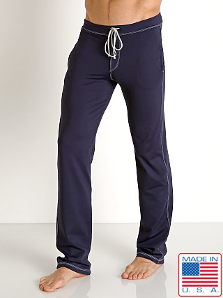 Model in navy Sauvage Low Rise Nylon/Lycra Workout Pant