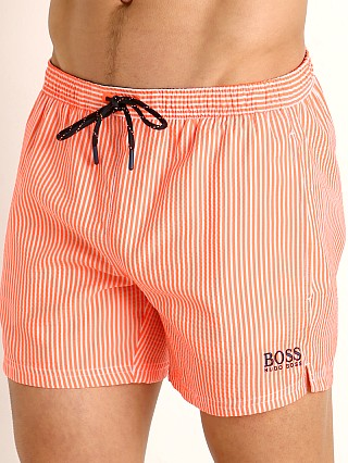 Model in orange Hugo Boss Velvetfish Swim Shorts