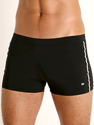 Model in black Hugo Boss Oyster Swim Trunk