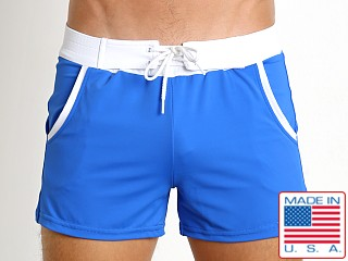 Model in cobalt Sauvage Pocket Retro Swim Short