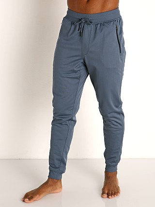 Model in mechanic blue Under Armour Sportstyle Tricot Pant