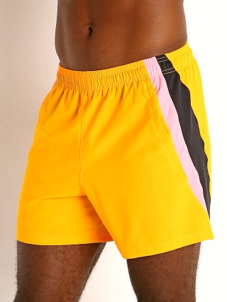 "Model in lunar orange Under Armour Launch 5"" Running Short"