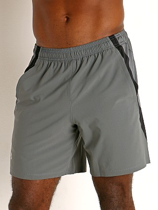 "Model in pitch gray/reflective Under Armour Launch 7"" Running Short"