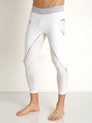 Model in white Under Armour Core 3/4 Compression Legging
