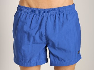 Model in blue Hugo Boss Thornfish Swim Shorts