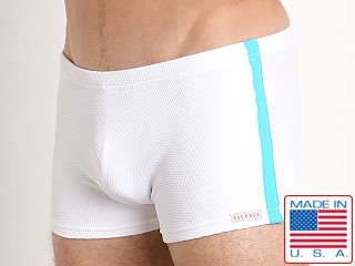 Model in white/turq Sauvage Pique Textured Squarecut Swim Trunk